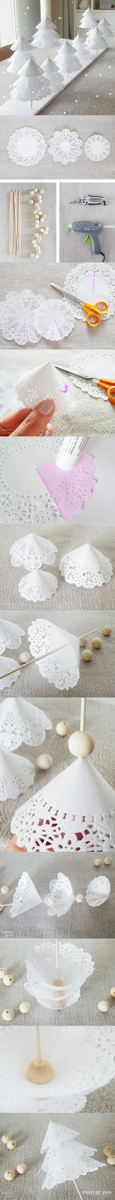 white Christmas trees made with 3 sized paper doilies