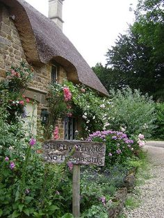 I don't know whose cottage this is. But it was so pretty, I just had to take a pic. I love the  roses.