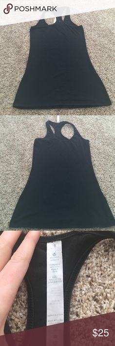 Lululemon size 6 racerback black tank Back logo is fading a little bit lulu does replace logos for free at the store lululemon athletica Tops