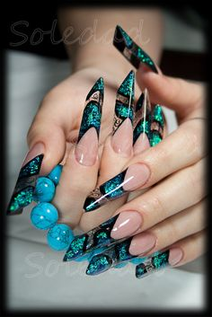 OUCH! Now these are gorgeous french tips, but a bit long  pointy.  - popculturez.com