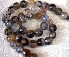 Black FIRE AGATE 8mm round, faceted BEADS, classy item