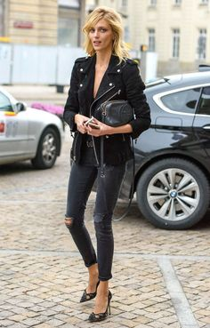 Shop this look on Lookastic:  http://lookastic.com/women/looks/biker-jacket-crossbody-bag-belt-skinny-jeans-pumps/7876  — Black Suede Biker Jacket  — Black Leather Crossbody Bag  — Dark Brown Leather Belt  — Charcoal Ripped Skinny Jeans  — Black Lace Pumps