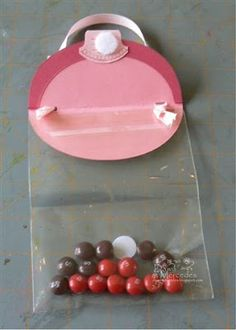 I have had quite a few requests for the directions to the Skittle Purse  that I made for a seminar display last month. My good stamping frie...