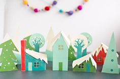 11 Pretty Paper Christmas Ornaments: Brightly Colored Paper Christmas Village Craft