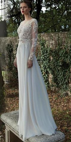 BB1333 This beautiful, bohemian wedding gown with long lace sleeves and open back in store now in size 10-12. Available for hire too. Come and visit us in Albany village on the North Shore. See more on http://bridalandball.co.nz/wedding-gowns/