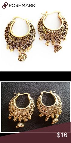 """Tibetan Gold Vine Antique Vintage Loop Earrings Stunning NWT Vintage Antique-Look Gold Tone Earrings.  Tibet intricately detailed swirl design with dangling charm embellishment.  The detail is too intricate to be picked up in these photos... Brilliant design!   1 3/4"""" long.  Post clips into the back side for secure hold.  We ship fast... Typically daily.   See the silver listed separately.  A FREE NWT gift is included with each purchase .  Bundle for 15% discount with our Tibetan bracelets…"""