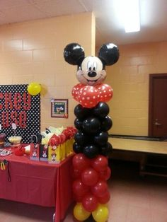 Mickey inspired balloon column.  See more Mickey Mouse birthday party and kids birthday party ideas at www.one-stop-party-ideas.com