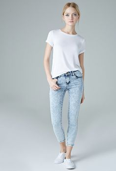 The Beverly – a pair of ankle skinny jeans featuring a low rise waist, acid wash, five-pocket construction, and zip fly.