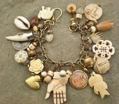 Earth and Bones Amulet Charm Bracelet by maggiezees on Etsy, $105.00