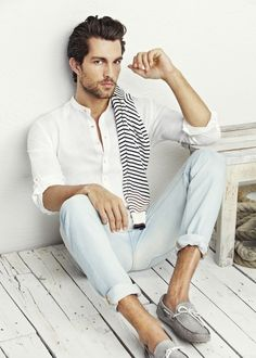 Not many men can pull of an all white and cream outfit, but this one works so well with the rolled up fitted slacks, slightly open fitted long sleeved T, and the added mini scarf in stripes...very beachy unique.