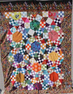 Jack's Chain- No Pattern. While looking for scrap quilt ideas on Pinterest, I came across this design. It was a hot mess trying to get the blocks aligned with the hexagons (9″) and the 60 degree triangles. I'm going to regret not using a pattern when it comes time to quilt this one. . .