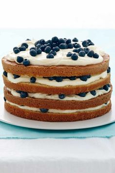 Lemon Blueberry Layer Cake: Leave the sides of the cake unfrosted so you can see the beautiful layers. Click through to find other easy Easter recipes for brunch, dinner, dessert, and more.