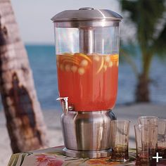 We entertain a lot. This Beverage Dispenser from Frontgate is great because it has two chambers to keep everything cold without diluting your drink! Score!