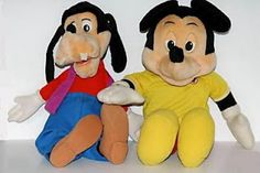I never had a Teddy Ruxpin, but I DID have the talking Mickey Mouse and Goofy!  They came with books and would read them to you.  SO cool!  I think I still have them both and the books!