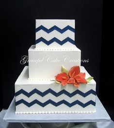 Simple And Elegant Square Wedding Cake with a Navy Blue Chevron  Design and Coral Calla Lillies