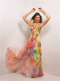 Blush Prom 9518 - Power in print in a formal prom dress! This gorgeous Spring flow of colors is highlighted by a single beaded strap that emerges under the bust. #prom