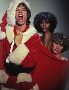 to all a merry christmas [Mick Jagger as Santa Claus with Iman Abdulmajid and Paul Van Ravenstein Mick Jagger Rolling Stones, Los Rolling Stones, Like A Rolling Stone, Rock N Roll, Moves Like Jagger, Simon Le Bon, Retro Christmas, Christmas Stars, Christmas Mood