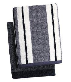 Deep blue towels bring nautical-inspired style to a white bathroom. Bath towels, $11.88 each. | #bathroom #nautical #decorating #towel #walmart #hometrends | Shop hometrends™ now at http://www.walmart.ca/hometrends/
