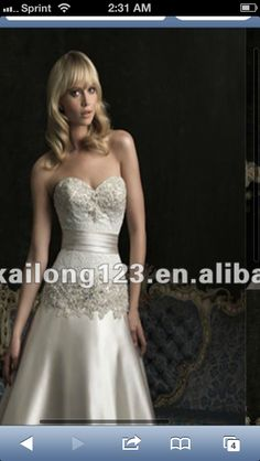Fitted trumpet gown with silver gem beading accentuates the waist form fitted #weddingdress
