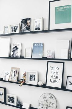 4. ARRANGE WALL ART ON PICTURE LEDGES Similar to the bookshelf idea, displaying artwork on shallow ledges creates a casual display that allows for layering and adds texture to the wall. (image via Ems Designblogg)