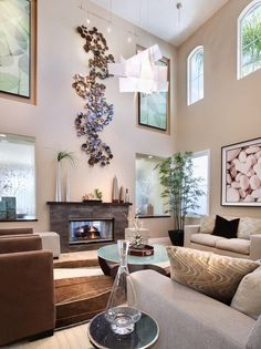 High Ceilings! How to decorate a large living room to make it feel cozy from homedit.com!