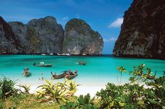 Thailand. Phi Phi Leh is a completely uninhabited island that lies 1.5km off the southernmost tip of Phi Phi Don. Most visitors will complete their Thailand travel trip by joining a day boat trip to this island to see those stunning sheer cliffs, rising from the sea.
