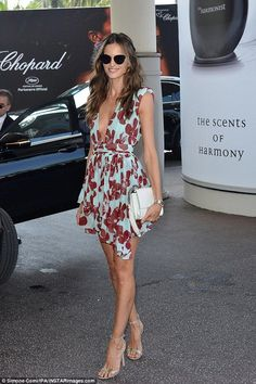 Sexy sighting: Izabel Goulart, 32, showcased her enviably slender frame in a perilously plunging floral dress as she headed out and about at the 70th annual Cannes Film Festival on Thursday