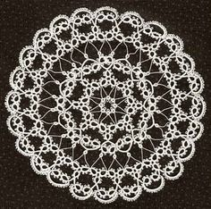 Here's the final doily! Now that I've redone the third row and blocked it, it's a lot more attractive. I hope you enjoy it. When made with size 30 thread, it is about 7.5 inches (…