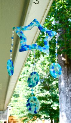 melted bead sun catcher - old pans, cheap plastic beads, I used the outdoor grill b/c the smell is awful, let 'em cool, pop 'em out, drill holes for hanging and stringing beads.
