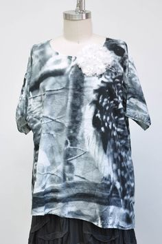 Features:   Basic pullover shirt  Short or Long Sleeve  Asymmetrical Hem  Over sized  100% Graphic Cotton Voile, Owl  Fits Sizes 2-20  Pictured with:Short Wavey Slip