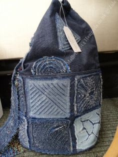 a bag made from my City & Guilds stitch and slash samples