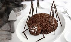 """Serve this eye-catching chocolate spider cake at your Halloween party, and it will double as your table's centerpiece! Chocolate sprinkles give this spider a """"hairy"""" appearance, and chocolate sticks make for the creepiest-looking spider legs. Chocolate sticks and candy eyeballs can be found at kitchen specialty stores and online. IfGet the Recipe"""