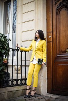 If you're going to wear a pantsuit, it might as well be bright yellow