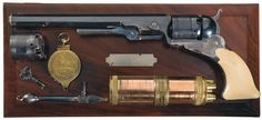 """A magnificent Colt No. 5 Paterson with its 6 silver banks, 9"""" barrel, loading lever, and shell carved antique ivory grips... yours for the low, low price of $805,000!"""