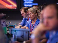 In this photo released by NASA's JPL, Members Mars Science Laboratory (MSL) team work in the MSL Mission Support Area at the Jet Propulsion Laboratory hours ahead of the planned landing of the Curiosity rover on Mars, Sunday, Aug. 5, 2012 in Pasadena, Calif.