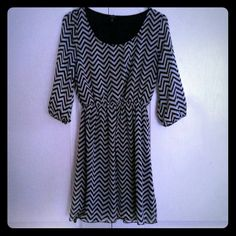 Black & white chevron dress Really comfy, cute, and versatile dress. You can wear it with boots and tights in cold months, flip flops in the summer, or high heels anytime. You can belt it with a black belt or a color pop belt like I did in the 2nd picture.  If you like it, make me an offer.  :-) 3 Dresses