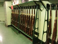 This rifle rack held M-1 Garand rifles, padlocks for security. These were the standard weapons of a ship's Marine Detachment. M-1s were considered by many to be the finest combat weapon ever issued. The ship's armory (located further below deck) also contained M-1 Carbines, Browning automatic rifles, Thompson sub-machine guns, M-97 riot shoguns, and Browning air cooled machine guns, all of which were available to the Marines on short notice.
