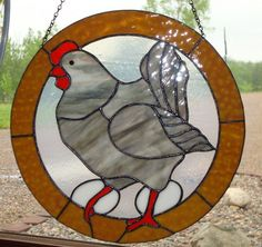 This is a stained glass chicken made in the Tiffany copper foil method. Beautiful piece!    Approx size: 13 1/2 round