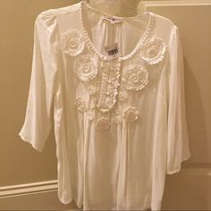 White Shear Top This is an adorable white shear three quarter length sleeve top. It has beautiful detailing and has never been worn. The tags are still attached. Altar'd State Tops