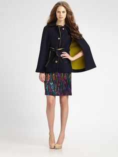 I'm not one for capes but this military inspired fabulousness is delightful.