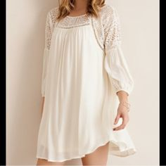 🏆HOST PICK🏆Ivory Cream Lace & Ivory Dress Lace upper border and crisscross strap upper back dress. Fully lined. Flow fit and feminine. This dress is also available in lilac color. Brand new for boutique retail. No trades, no holding no offsite/App payment.       🗣 PRICE IS FIRM, no offers entertained                    💙 Bundle and save 💚 Dresses Mini