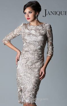 Lady-like elegance! This cocktail dress showcases a bateau neckline with sheer laced sleeves in three quarter length. A knee length dress covered with sheer laced in floral design for a dainty and glamorous look.Janique W041 by Janique $498.00 Comes in Pewter, Champagne and Midnight.