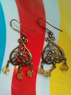 Antiqued Brass Earrings with Honey-Colored Glass Beads ($22)