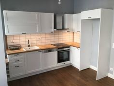 An ideal layout for a small kitchen is the L-shaped one, as it allows you enough preparation area while being able to walk comfortably in the room. Farmhouse Kitchen Cabinets, Farmhouse Style Kitchen, Painting Kitchen Cabinets, Kitchen Cabinetry, Kitchen Paint, Kitchen Tiles Design, Kitchen Wall Tiles, Kitchen Cabinet Design, Small Cottage Kitchen