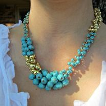 Turquoise and gold tone cluster bead necklace. Comes with matching earrings!