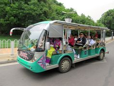 Electric carts of this kind shuttle visitors around the Stone Forest at Shilin near Kunming, Yunnan, China. David Stanley, Kunming, Electric, China, Stone, Rock, Batu, Porcelain, 1st Birthdays