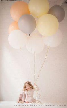 Oversized balloons - child photography idea.