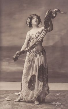 Vintage Turn-Of-Century photo of exotic dancer with snake