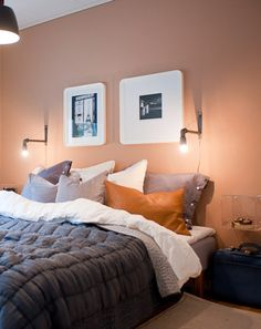The color combination here minimizes the femininity of the peach wall color. The dark mixed with the leather, mixed with the stark white gives the walls an opportunity to melt into the background so much more. Living Room Inspo, Basement Wall Colors, Feature Wall Bedroom, Bedroom Interior, New Living Room, Small Bedroom, Peach Bedroom, Home And Living, Bedroom Wall Colors