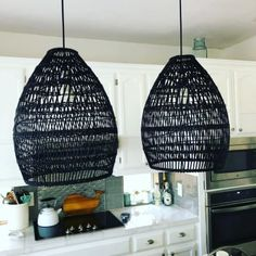 Expertly handwoven of bamboo by Vietnamese artisans to allow ambient light to shine through, our teardrop pendant shade is finished in black for added drama. Bamboo Light, Bamboo Lamp, Black Bamboo, Wicker Pendant Light, Black Pendant Light, Pendant Lamp, Pendant Lights, Dining Room Light Fixtures, Kitchen Pendant Lighting